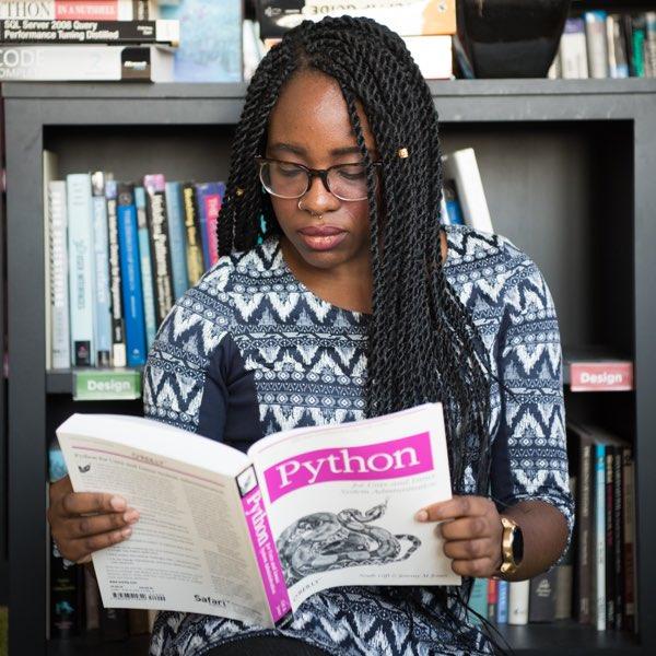 Woman reading Python book